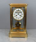 French striking four glass clock